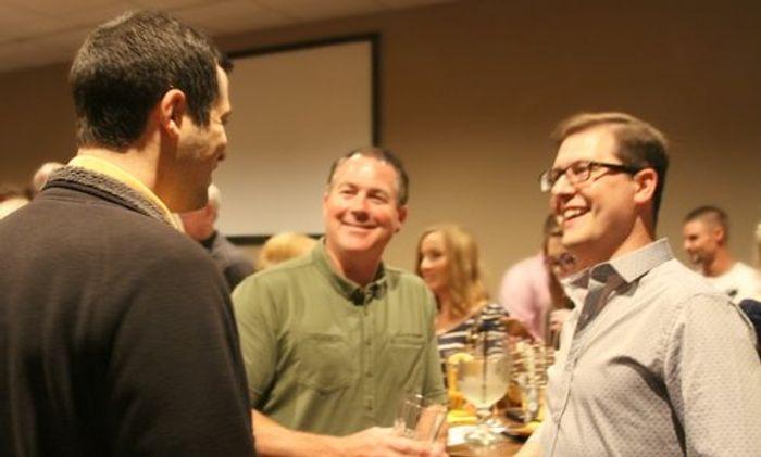 Dr. Brand, Dr. Fritz, and Dr. Brett McKnight celebrating.