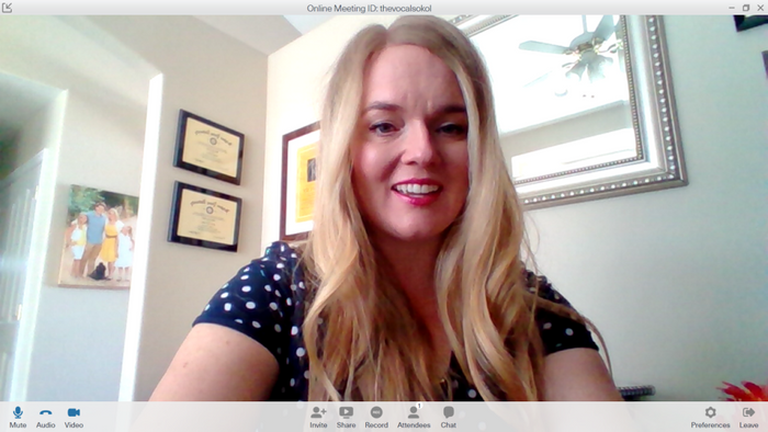 See the weird shadows on my face? I'm killing my first impression! Notice the way less flattering angle? This is what I look like if I just set the laptop on the desk with no platform.